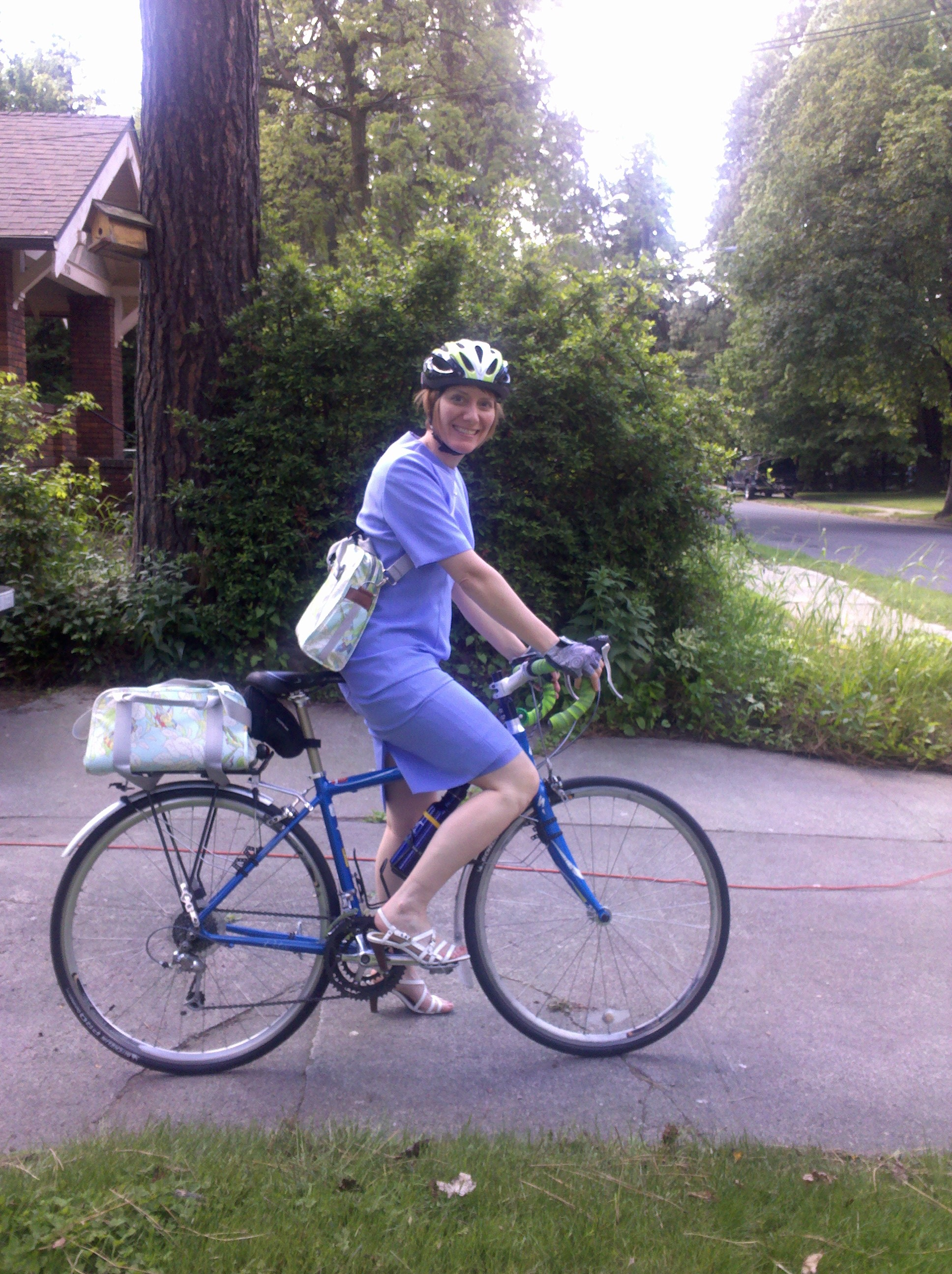 Dressed for the commute: Periwinkle blue dress, bike, Po Campo bags.